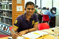 Rishabh Passwala studying at Cedarbrae Library.