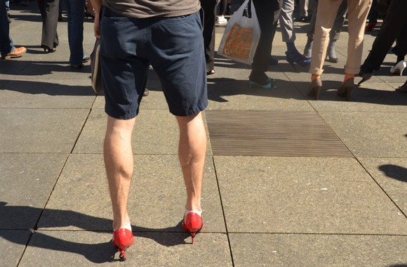 About 600 men traded in Oxfords for high heels in a bid to raise money for the White Ribbon campaign.