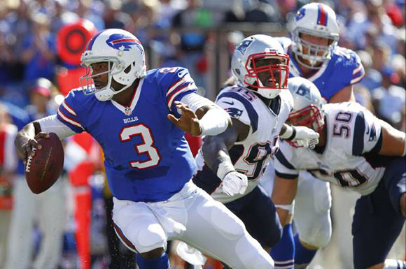 Buffalo Bills rookie QB E.J. Manuel (3) avoids the rush in his debut against the New England Patriots. (AP Photo/Bill Wippert)