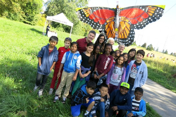 City Councillor Glenn De Baermaeker and the kids from Bendale Junior Public School get ready to plant wildflowers in the new butterfly meadow