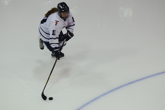 Katherine Gale skates with the puck at Varsity Arena in the Blues' 5-0 victory over the Ryerson Rams Thursday. (Ryan Horne/Toronto Observer)