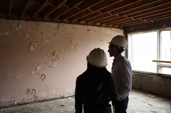 Observer reporter, Nicolette Mendoza, observes the state of the townhouses with Magnum Opus Group chairman, Jeffrey Feldberg.