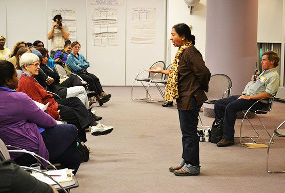 Babli Nessa, 59, addresses the audience during a performance for And Here We Dwell at Metro Hall (55 John St.) on Oct. 18
