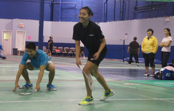 Michelle Li, centre, trains as her coach Jennifer Lee, back right in yellow, looks on. (Curtis Ng/Toronto Observer)