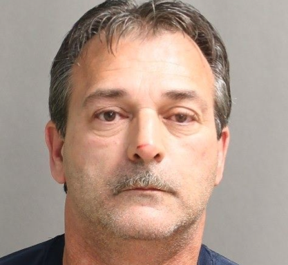 Donald Mosher, 54, of Toronto charged for sexual assault of a young boy.