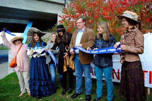 Coun. Gary Crawford, centre, helps cut the blue ribbon on Oct. 20 to mark the completion of the Warden Underpass Mural. From left: a local resident, artist De Anne Lamirande, Coun. Michelle Berardinetti, contributing artist Emma, Crawford, another resident and contributing artist Emilia Jajus.