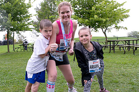 Colin Dodds, 7, with mom Cori and sister Arianna, 9, just after finishing the 500-metre Cub Run at the Toronto Zoo on Sept. 21.