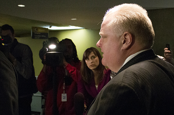 Running a bit late: Toronto Mayor Rob Ford emerged from City Hall's second floor elevators to a waiting throng of media.