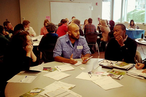 Kyle Baptista (centre), coordinator of park projects and communications with the alliance Park People, spoke with Scarborough residents on how to effectively engage social media into community park projects.