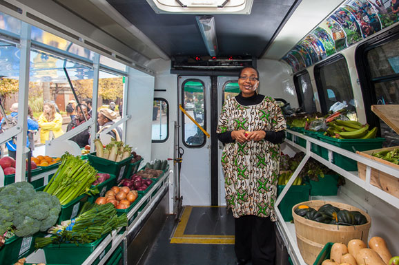 Afua Asantewaa, coordinator of the Mobile Good Food Market, stands inside the project's newly remodelled food truck, which was formerly used as a Wheel-Trans bus and was donated by the TTC.