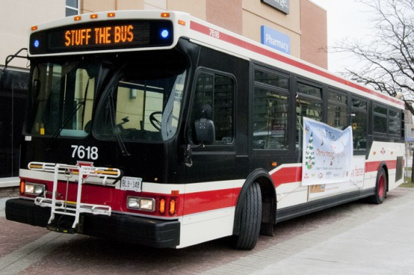 A TTC bus stands ready to accept toys at Wal-Mart's Markham Road and Eglinton Avenue East location during this year's Stuff-the-Bus Toy Drive. Last year, the toy drive helped 675 families and more than 3,000 children, said Kevin Kane, an organizer and founder of Stuff-the-Bus.