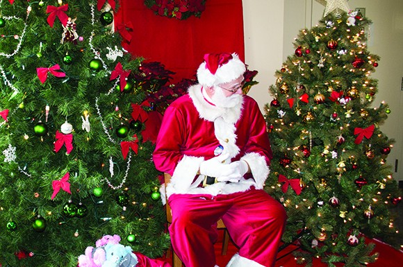 Santa Claus comes to St. Matthew's Lutheran Church during the Christmas Bazaar on Nov 23.