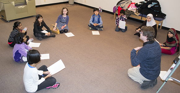 Several young scholars learn about Shakespeare's plays at a TD Shakespeare for Kids Library Club workshop at the Highland Creek library branch. The club is run by Shakespeare in Action, a literacy program for children ages 7 through 12.
