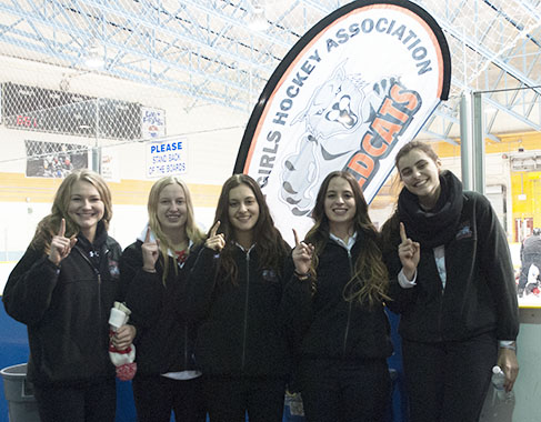 Five Leaside teammates show the number one sign before their game. This was their first time facing a national team.