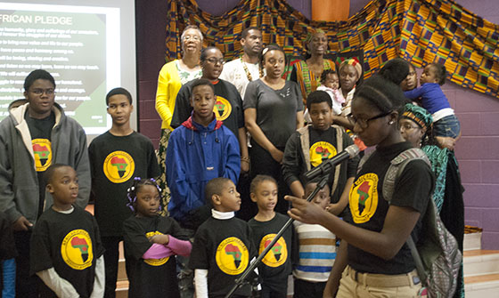 "The African Canadian Heritage Association held its annual Kwanzaa Showcase on Dec. 7. Above, performers recite ""The African Pledge"". The first two lines are ""We are an African People!! We will remember the humanity, glory and suffering of our ancestors."""