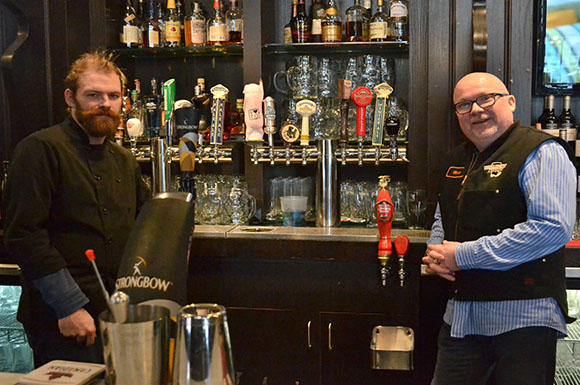 Fox sous chef Fraser Kennedy, left, and Matt Simons, the bar's general manager, are ready to host some of the 100 million people expected to watch the Super Bowl at a sports bar or at home on Feb. 2.