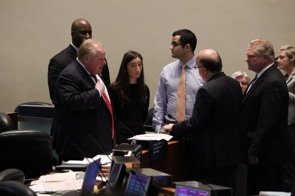 Mayor Rob Ford speaks with councillors during the budget debate.