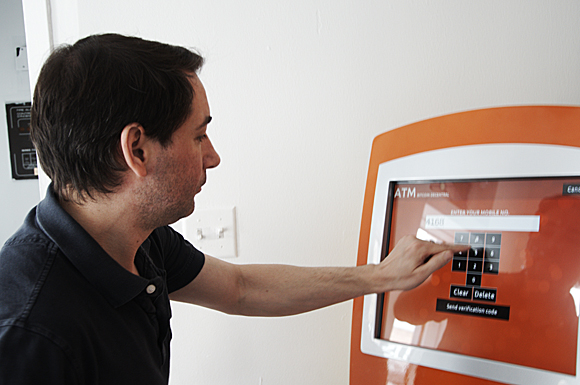 Anthony Di Iorio, executive director of the Bitcoin Alliance of Canada, demonstrates how to use Toronto's first bitcoin ATM
