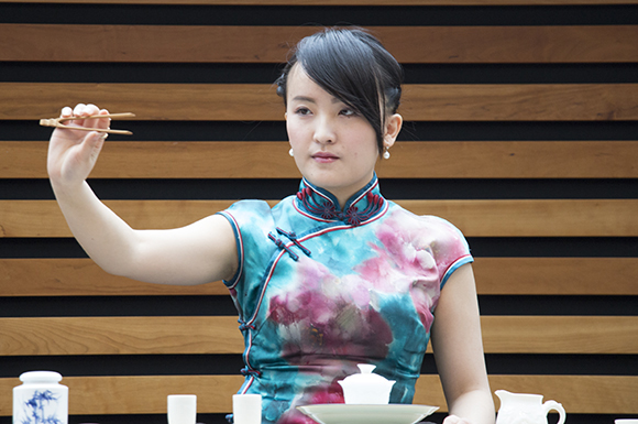 Sabrina Chen shows a pair of tongs used to hold hot dishes during a demonstration of a Chinese tea ceremony at the Toronto Tea Festival. The second-annual festival ran Feb 1–2 at the Toronto Reference Library's Bram and Bluma Appel Salon.