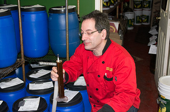 Charles Fajgenbaum,  owner, measures a beer sample at Fermentations. Clients can customize a brew recipe at his shop.