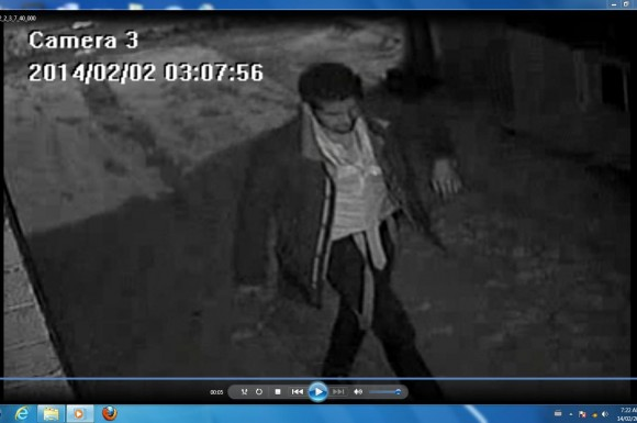 Security camera photo of suspect wanted in break-and-enter case.