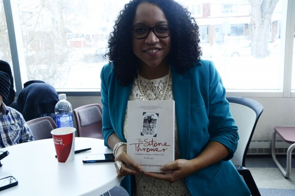 Jael Ealey Richardson, holds her book, The Stone Thrower, about her famous father.