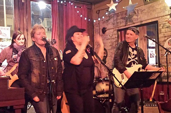 Elana Harte, second from right, performs with Stiletto Flats at The Old Nick. 'You go into music because you love it, because you want to play 25 hours a day,' Harte says.