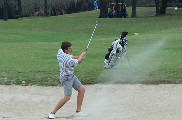 Purdue University senior golfer Adam Schenk chips out of a sand trap on the 13th hole at Lake Jovita Golf and Country Club in Dade City, Fla., during the final round of the USF Invitational. The Vincennes, Ind., native placed second.