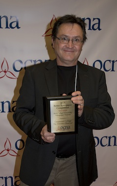 Centennial College journalism professor Neil Ward accepts the Toronto Observer's second-place award in the University/College website category at this year's Ontario Community Newspapers Association Better Newspaper Competition. It's the second top-three finish in the category for torontoobserver.ca in three years.