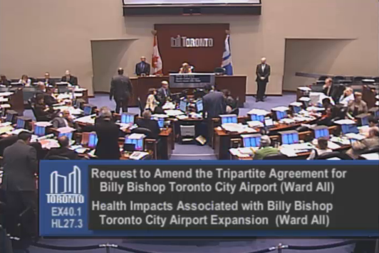 City council debate island airport extension.