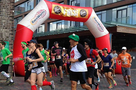 Participants in a variety of costumes set out for the first edition of the Toronto Beer Run