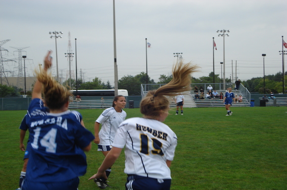 Humber's Lindsay Smith battles for the ball with Niagara's Jackie Lawther.