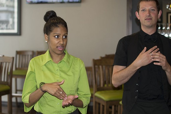 Chadni Sugrim (left) and Alexandrose Dayment speak at Signs restaurant.