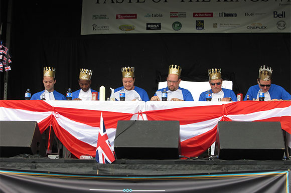 Six courageous contestants dig into heaping portions of fish and chips at the Taste of the Kingsway