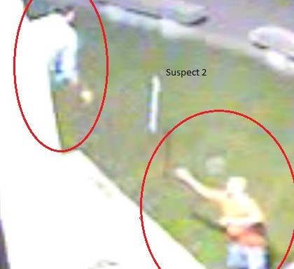 Security camera image released by police of suspects in theft and mischief to historical monument.
