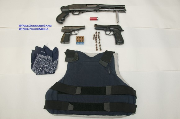 Peel Police seized a number of firearms, drugs, cash and body armour in a Mississauga search warrant Tuesday.