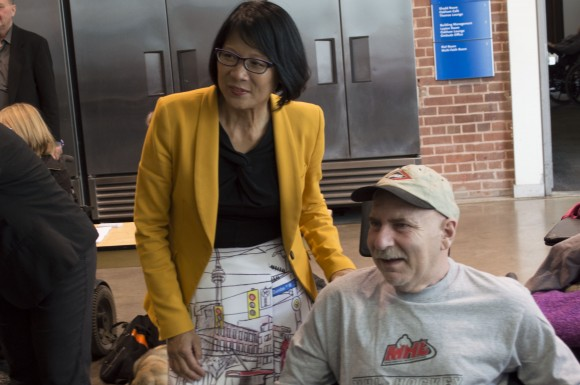 Olivia Chow poses with a member of the audience after a mayoral debate on issues affecting people with disabilities at the Ryerson Student Centre Monday.