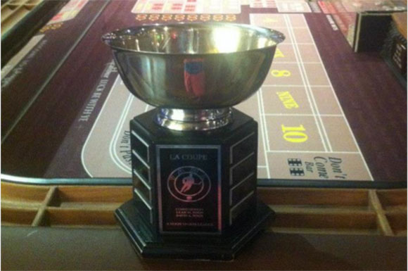 """Nicknamed """"la coupe,"""" the York adult league championship trophy is given to the winning team at the end of each season."""