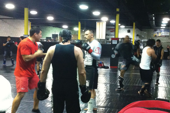 MMA instructor leading a training session with students at Xtreme Couture in Etobicoke.