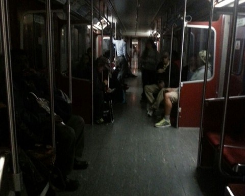 Passengers waiting in the dark on the TTC as subway stopped at Kennedy Station for emergency