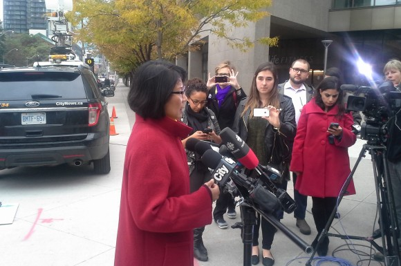 Olivia Chow talks to reporters in front of City Hall on Wednesday.