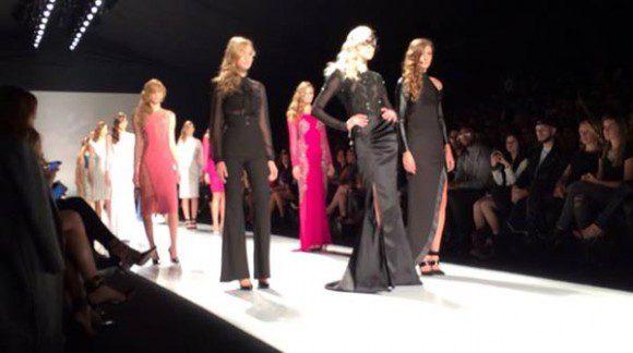 Models walk down the runway at Toronto Fashion Week.