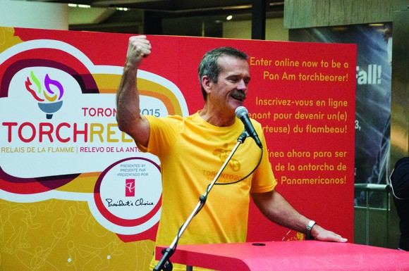 Former astronaut Chris Hadfield gives a speech after he was announced to be the first torch bearer for the 2015 Pan Am Games in Toronto on Wednesday.