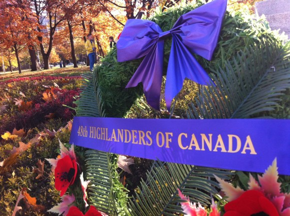 Just north of the salute, wreaths decorated the 48th Highlanders Regimental Memorial.