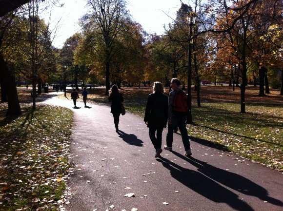 Pedestrians lined the paths at Queen's Park on the beautiful fall day, warmer than usual and sunny.