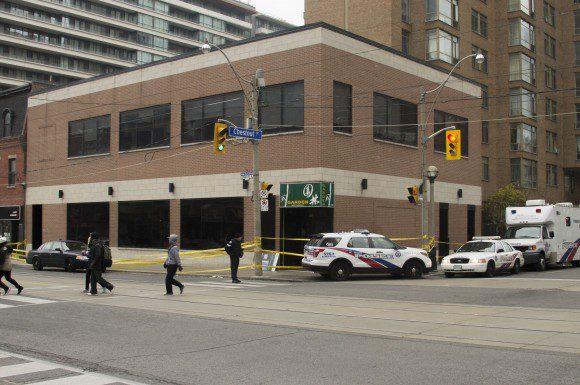 Toronto Police forensic team investigates the shooting at the Garden Restaurant Nov. 16, 2014.