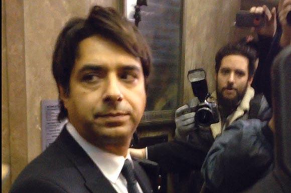 Jian Ghomeshi leaves the court room.