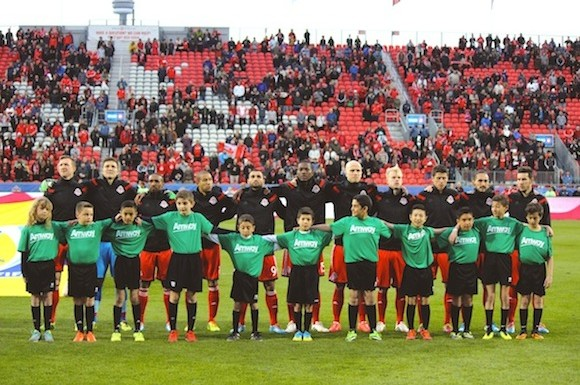 Toronto FC players line up in the singing of the Canadian national anthem before their game versus Vancouver.