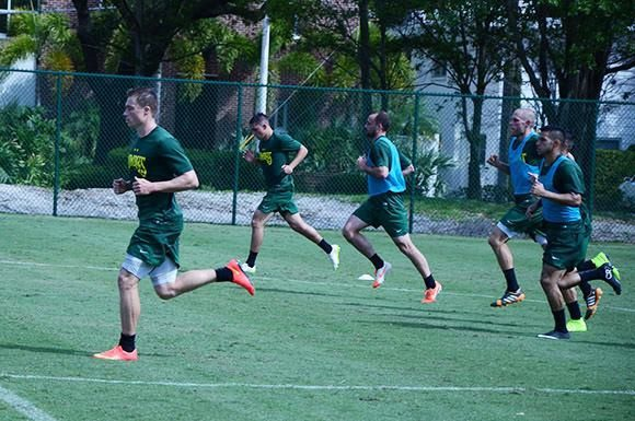 Rowdies forward Zak Boggs (far left) leads the pack during a team practice on Thursday.