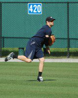 Connor Harrell, a Detroit Tigers outfield prospect, completes a throw to a teammate at the Tiger Town training facility in Lakeland, Fla.